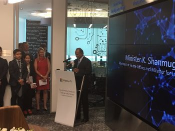 Singapore's Minister for Home Affairs and Minister of Law, K. Shanmugam officiates the opening of the centres