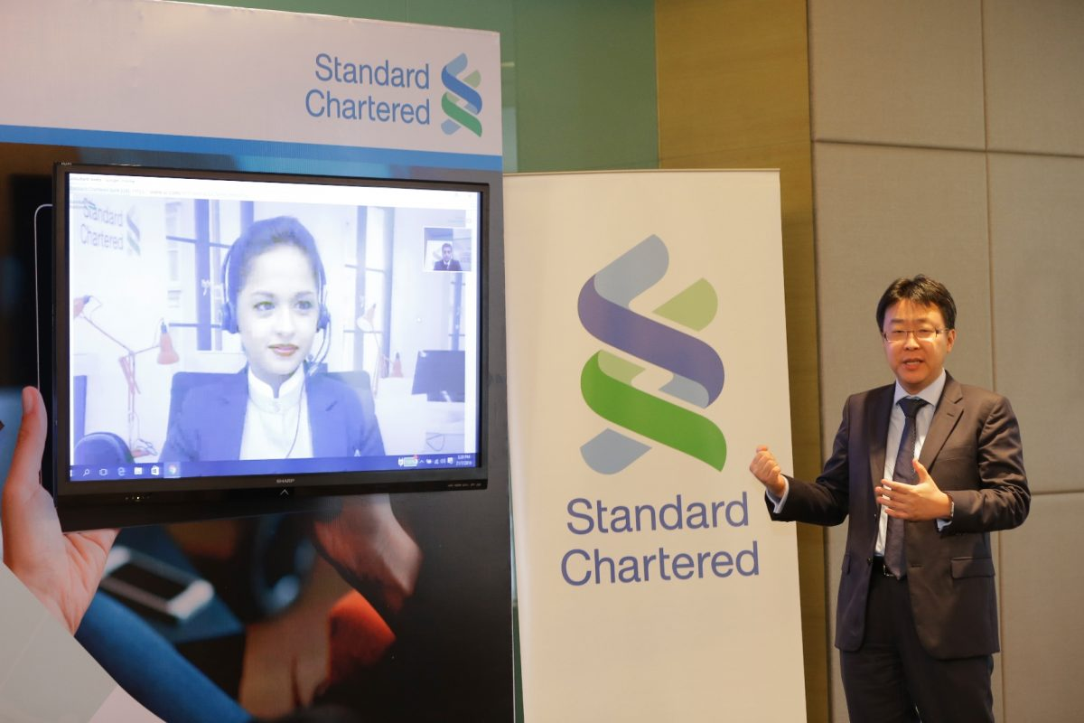 Aaron Loo, Country Head, Retail Banking, Standard Chartered Bank Malaysia performing a live demo of Standard Chartered Video Banking